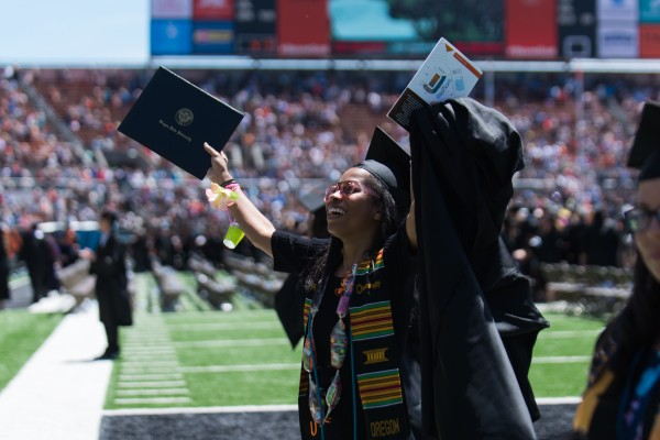 Black student celebrating commencement in Reser Stadium