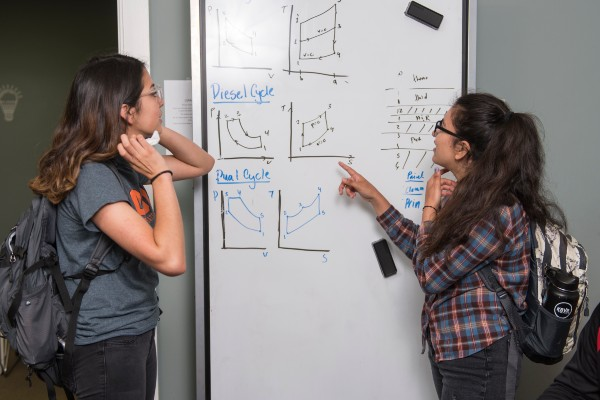 photo of two LSAMP students in front of whiteboard